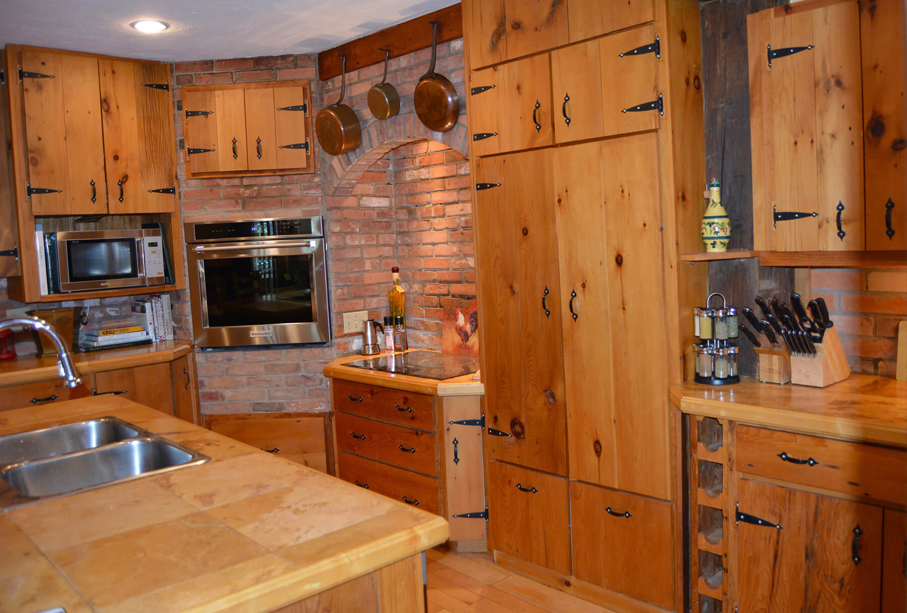 Avalon Kitchen brick stove and oven, wood cupboards, island sink